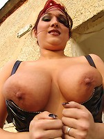 Vendy stripping off to show off her hooters and shaved pussy