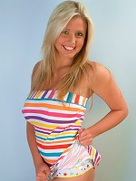 Busty teen Emily gets playful in her striped dress