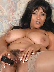 British milf Danica plays with her huge melons and fingering