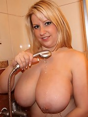 Plumper Bubble Kay plays with her giant melons in the shower