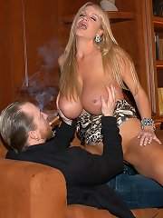Kelly gets smoke blown on her tits then bent over a couch in the library and fucked hard from behind.