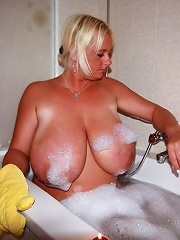 Busty babe EMilia Boshe plays with her massive tits in the bath while getting soapy. More free emilia boshe vids here