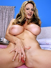 Big boobed blonde centerfold morgan Leigh getting mother-naked and posing.