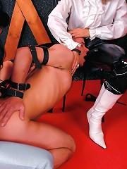 Dominatrix Babe Gives BDSM Shop Customer Demonstration in Strap-On Fucking Her Gimp