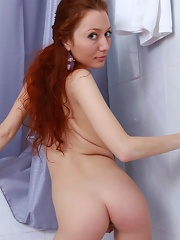 A stunning redhead with tiny boobs and a lightly furred slit