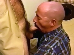 Hairy men gagging on meat stick