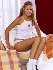 Adorable young blondie shows off her tanned slim body.