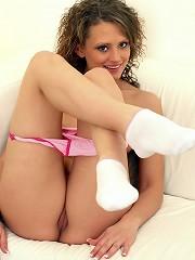 Gorgeous teenager caressing boobs