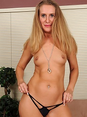 43 year old blonde Sara J performs a steamy striptease in here