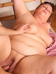After he fucks the sexy granny he pulls out and cums on her pussy so she can taste it