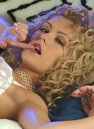 Sexy blonde spreads and fingers her sweet pussy
