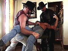 This lucky cowboy gets dragged inside so the other two bears can suck him off