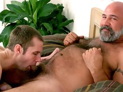 Young gay boy gives a head to hairy older daddy