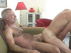 Muscle bear riding a mature dick