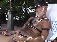 Leather daddy playing with his big cock