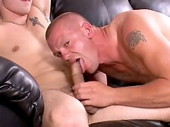 Two muscular guys have blowjob fun on the couch