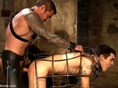 A brutal Nick Moretti fucks a pain slut in a metal cage in these free gay fetish videos
