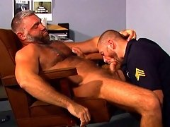 Hung and hairy bear fucks this muscled policeman after gets him sucking cock
