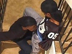 An ebony gangster gives a head