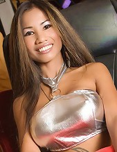 Incredible Asian babe in a sexy silver top gets ready for action