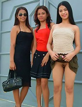 Three hot Filipina babes ride and flash pussy in public