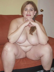 Adorable chubby redhead massaging her wet mound