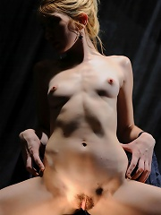Pretty blonde with no inhibitions in wide open poses.