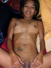 Tiny Thai hooker plays with a huge cock