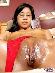 Tiny chinese opens her shaved pussy wide