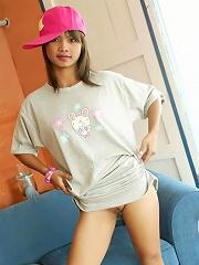 Teen Thai girl Tussinee in her pajamas and pink cap