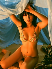 Gorgeous asian beauty shows off her round full tits in lingerie