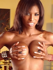 Chocolate Natassia posing in her sexy brown dress