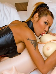 Hot t-girl practices her skills with a rubber doll