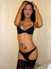 Asian T-girl in sexy black lingerie