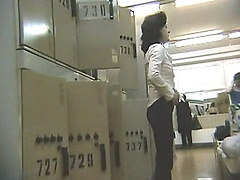 Hot lady takes off her trousers in locker room