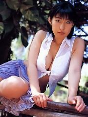 Incredible asian babe in a bikini shows off her big plump boobs