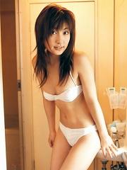 Divine asian babe with plump bouncy boobs in a white bikini