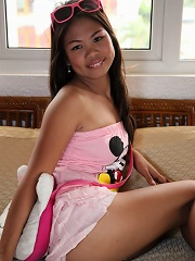 Asian MILF in pink dress gets all wet for foreign guy